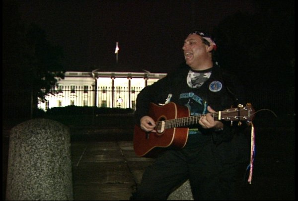 Craig singing passionately in front of the White House, leading the parents & families with missing and abducted children in song